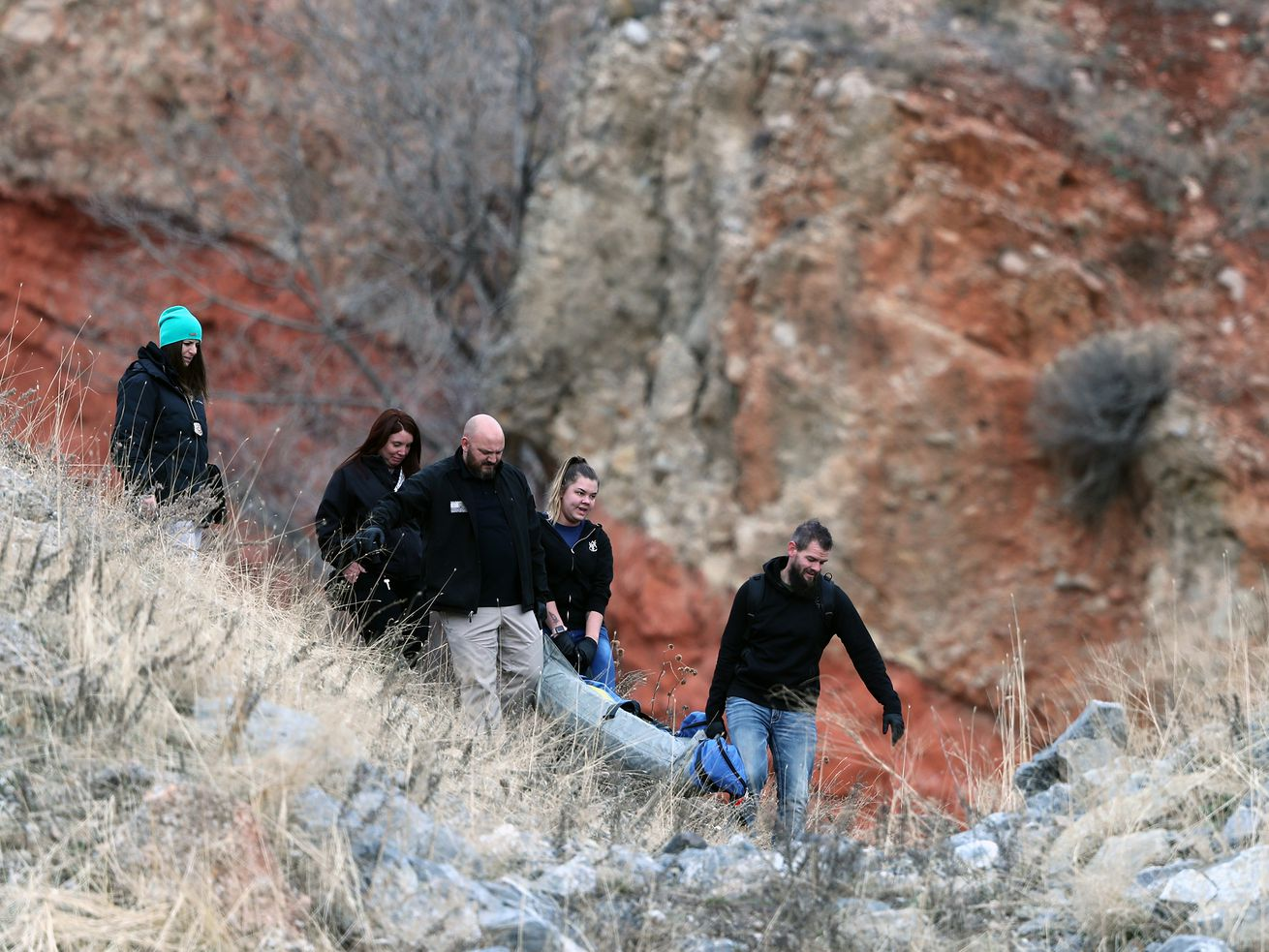 Officers bring the body of a person that was found by a hiker off the mountain near Hell Canyon in Salt Lake City on Sunday, Jan. 5, 2020.