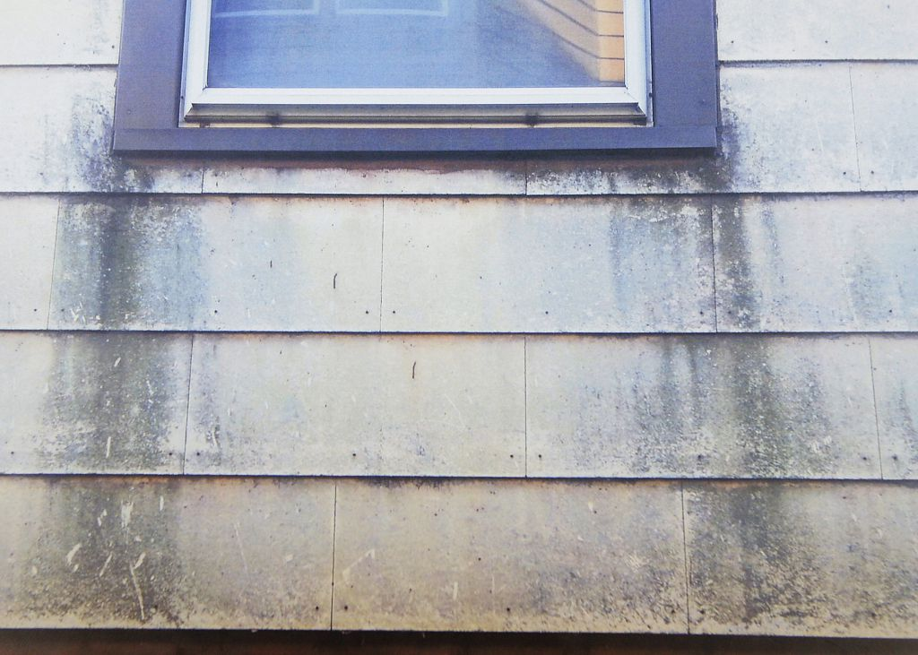 Dust buildup is shown on a house in the 10th Ward where the KCBX Terminals Co. stores petcoke.  | Provided photo