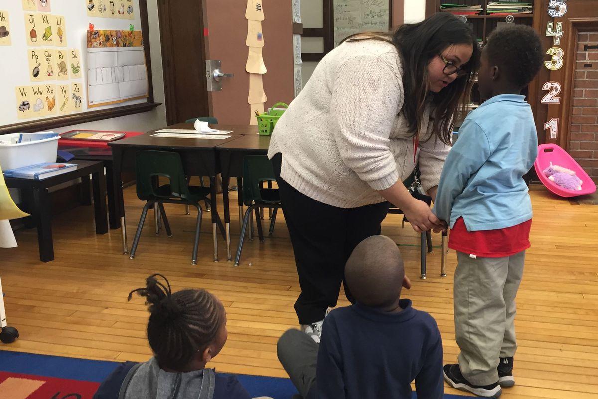 Kindergarten teacher Stefanie Kovaleski speaks with a student at Detroit's Bethune Elementary-Middle School.