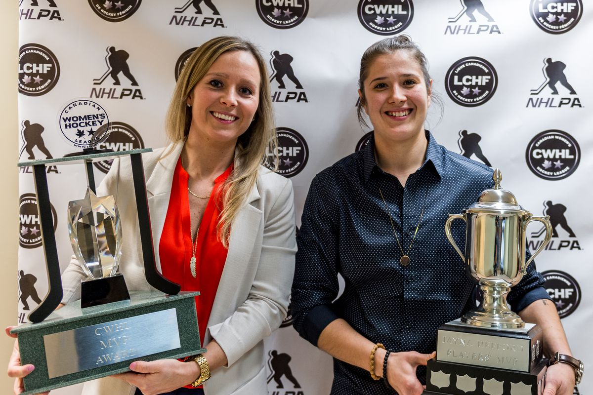 Kelli Stack of the Kunlun Red Star holds the CWHL MVP trophy and Jamie Lee Rattray of the Markham Thunder holds the Jayna Hefford trophy