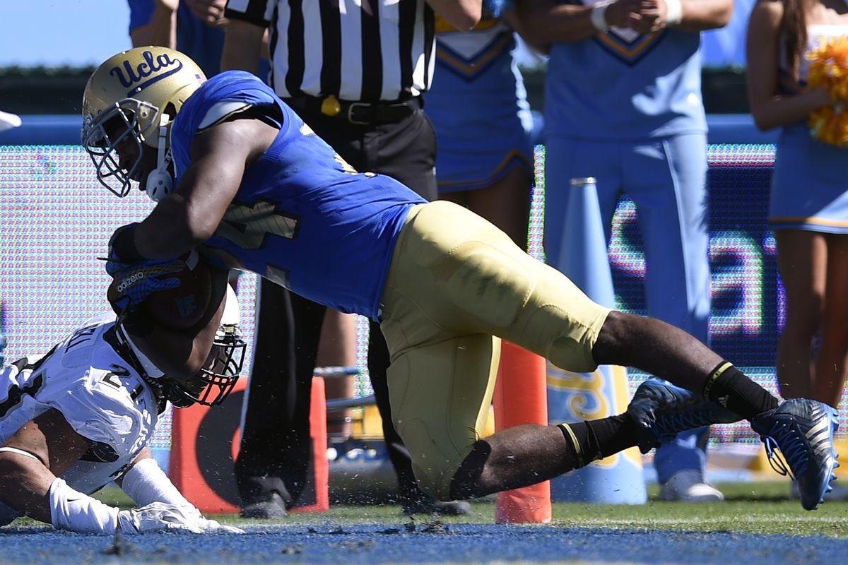 Paul Perkins finds the end zone for UCLA's first touchdown of the day