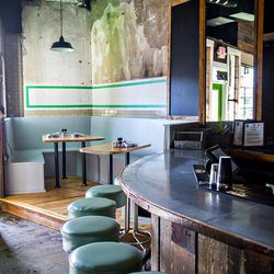 The bar and some new seating options at The Family Dog.