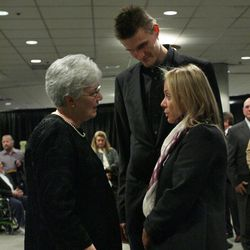 Andrei Kirilenko and his wife, Masha, pay respects to Gail Miller during the viewing for Larry H. Miller on Feb. 27, 2009, in Salt Lake City. The Kirilenkos' Salt Lake home was burglarized over the weekend.