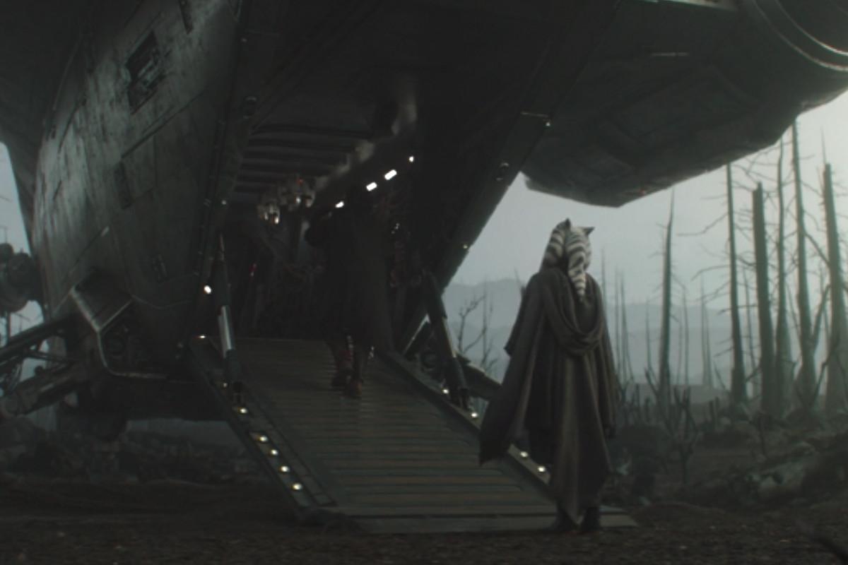 The Mandalorian boards his ship as Ahsoka tano's back faces camera