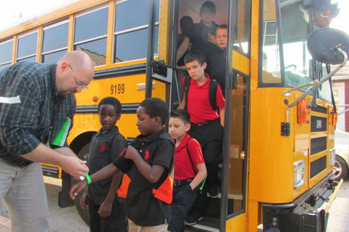 Students arrive for the first day of school last week at IPS School 14 in 2014.
