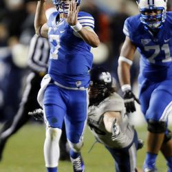 Christian Stewart (7) of the Brigham Young University Cougars throws an interception against USU during NCAA football in Provo, Friday, Oct. 3, 2014.