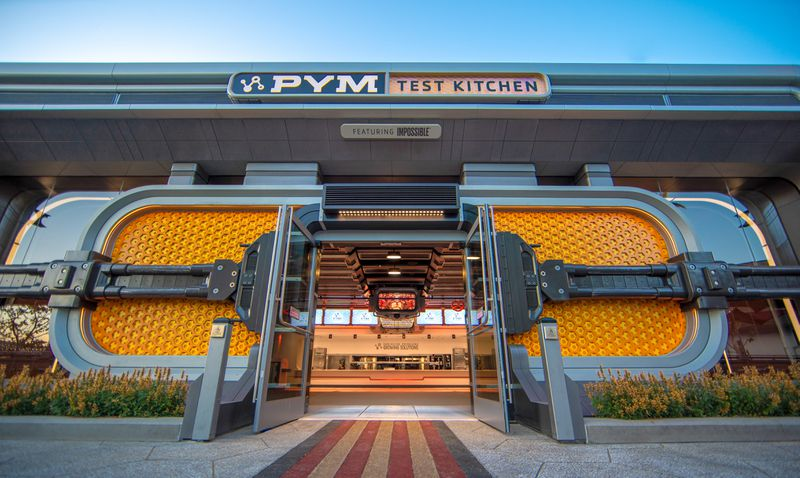 Yellow futuristic doors form the entrance to a futuristic restaurant.