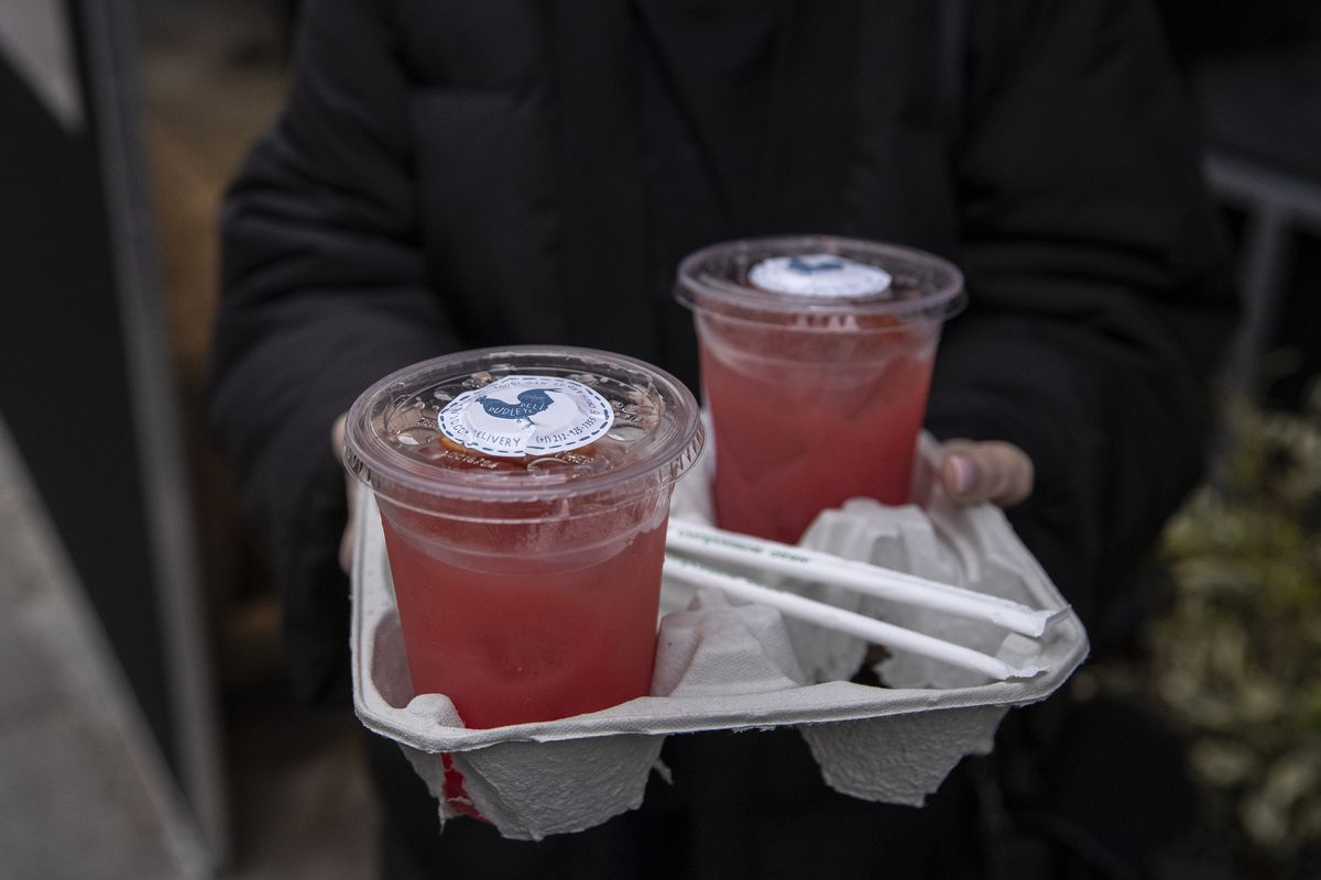 Cocktails are for sale to go at Dudley's bar and restaurant in Manhattan as the Coronavirus, COVID19, outbreak continued unabated on March 19, 2020 in New York City.