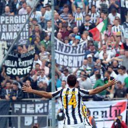Juventus' Mirko Vucinic,of Montenegro, celebrates after he scored during a Serie A soccer match between Novara and Juventus at the Silvio Piola Stadium in Novara, Italy, Saturday, April 29, 2012.