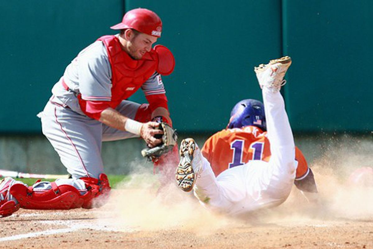 Clemson's Kyle Parker slides past North Carolina State catcher Chris Schaeffer in the bottom of the eighth inning to extend the lead for the Tigers in the first of two games at Doug Kingsmore Stadium. Clemson won 12-7.