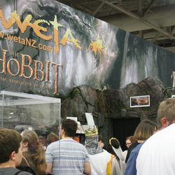 Participants wander through the Weta Workshops booth at Comic Con. Salt Lake Comic Con hosted hundreds of vendors during its three-day event.