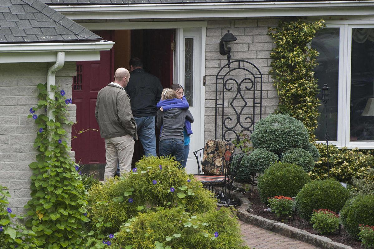 Visitors arrive at the home of Jeffrey Giuliano in New Fairfield, Conn., Friday, Sept. 28, 2012. Giuliano fatally shot a masked teenager in self-defense during what appeared to be an attempted burglary early Thursday morning, then discovered that he had k