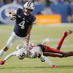 BYU Cougars running back Lopini Katoa (4) is hit by Liberty Flames safety Isaac Steele (13) as BYU and Liberty play a football game in Provo, Utah on Saturday, Nov. 9, 2019. BYU won 31-24. Katoa was named to a 2020 Doak Walker Award watch list.