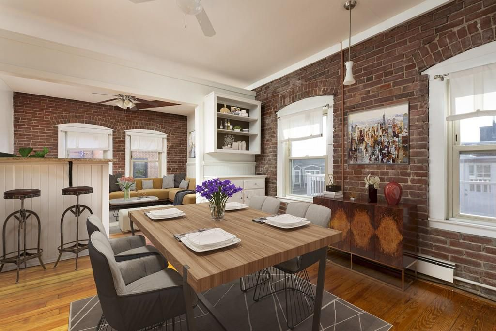 An open dining area with a table and chairs.
