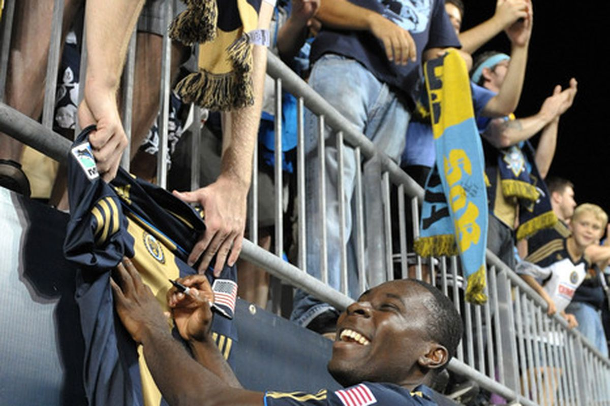 CHESTER, PA- AUGUST 13: Freddy Adu #11 of the Philadelphia Union signs autographs after the game against FC Dallas at PPL Park on August 13, 2011 in Chester, Pennsylvania. The game ended 2-2. (Photo by Drew Hallowell/Getty Images)