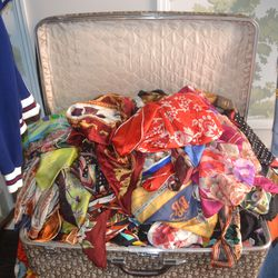 Silk scarves (bursting out of Dior luggage) start at $7.