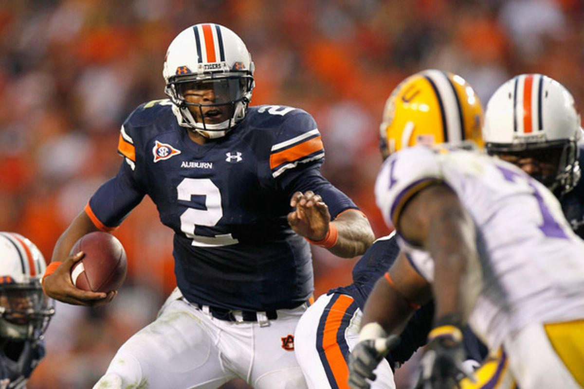 AUBURN AL - OCTOBER 23:  Quarterback Cameron Newton #2 of the Auburn Tigers rushes upfield against the LSU Tigers at Jordan-Hare Stadium on October 23 2010 in Auburn Alabama.  (Photo by Kevin C. Cox/Getty Images)