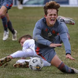 Brighton's Levi Jones (front) collides with Skyline's Sam Kirkham during a soccer match at the Cottonwood Heights Recreation Center on Friday, March 26, 2021.