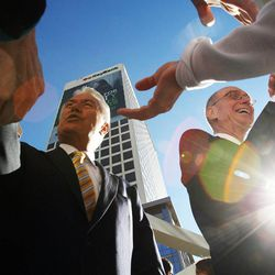 President Dieter F. Uchtdorf, left, and President Henry B. Eyring of The Church of Jesus Christ of Latter-day Saints greet people following a ceremony to open City Creek Center in Salt Lake City, Thursday, March 22, 2012.