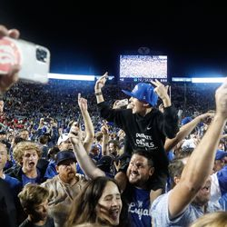BYU fans celebrate after winning an NCAA college football game against Utah at LaVell Edwards Stadium in Provo on Saturday, Sept. 11, 2021. BYU won 26-17.