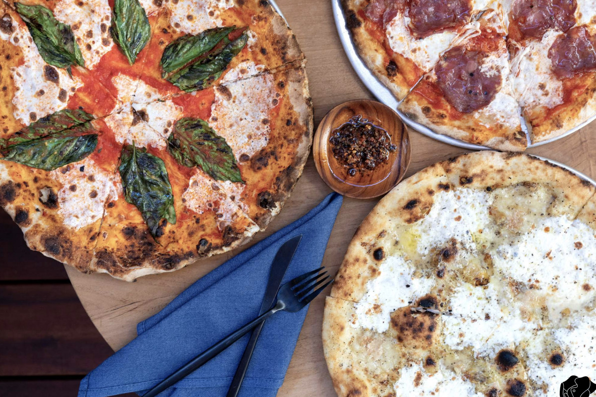 Pizzas, blistered and shot from overhead, shown at Elephante in Santa Monica.