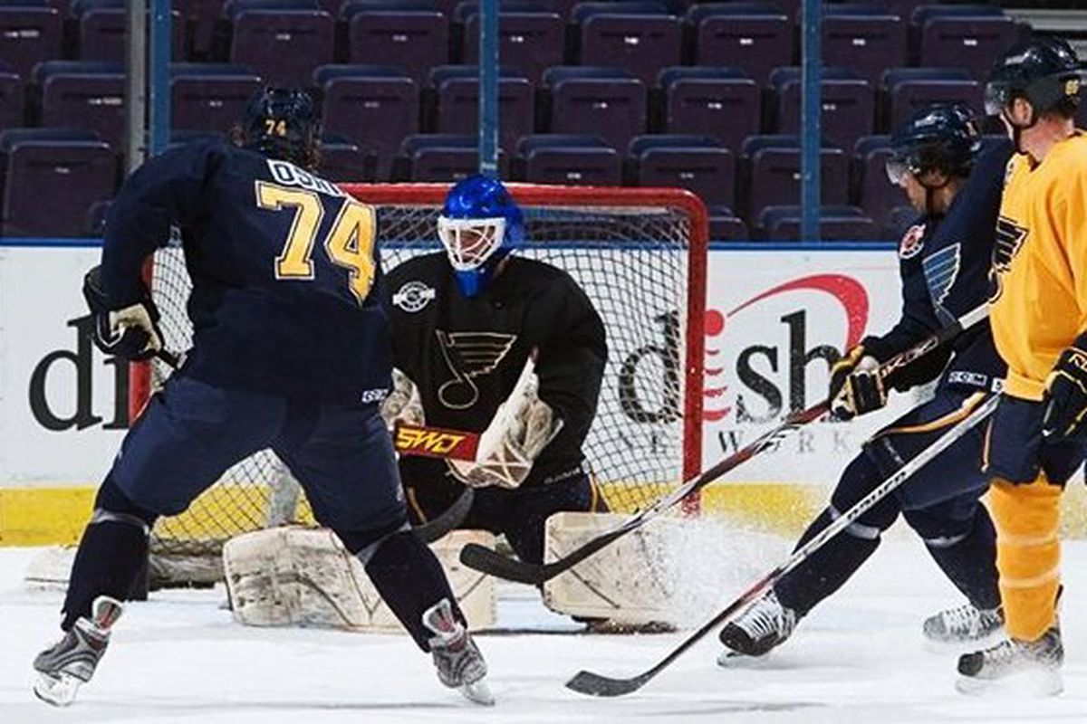 Karpowich, above, makes a stop against TJ Oshie during the Blues prospect camp in 2009.