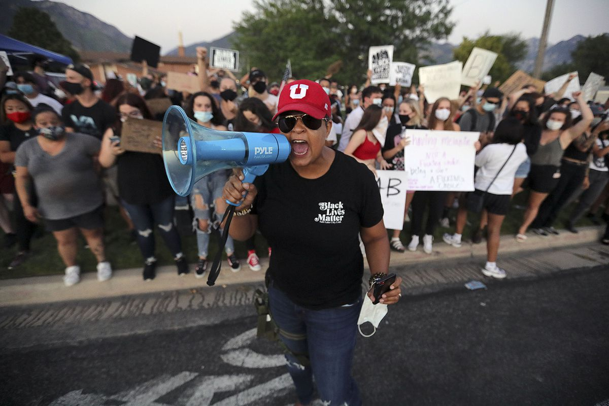Lex Scott, founder of the Utah chapter of Black Lives Matter, is pictured with a bullhorn in Cottonwood Heights.