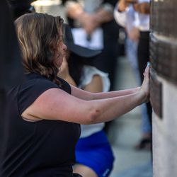Ashley Lyday, widow of fallen Ogden Nathan Lyday, installs a plaque bearing her husband's name on theUtah Law Enforcement Memorial at the Capitol in Salt Lake City on Thursday, May 6, 2021, during the annual Utah Police Memorial Service.