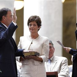 Lt. Gov. Gary Herbert is sworn in Tuesday as the new governor of Utah by Chief Justice Christine Durham in the rotunda of the state Capitol. Herbert's wife, Jeanette, holds the Bible.