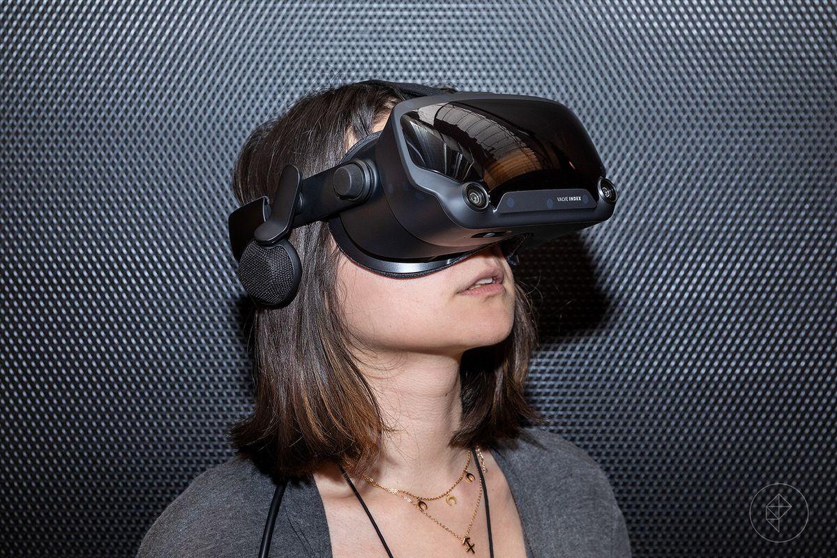 A woman wearing a modern-looking VR headset