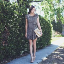 """Bethany of <a href=""""http://outofabook.blogspot.com/"""">Snake's Nest</a> is wearing a d.RA dress, Shoemint shoes, a vintage bag and Jewelmint rings."""