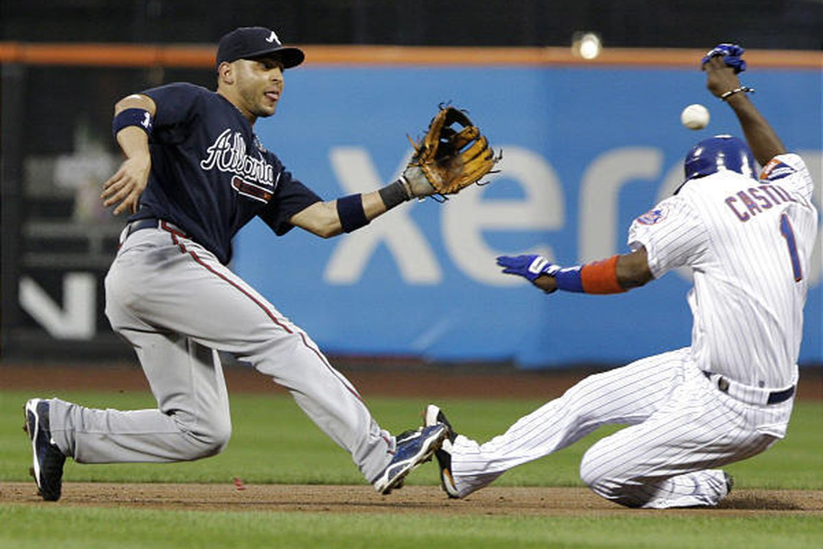Second basebamn Omar Infante waits for the throw to tag out New York Mets' Luis Castillo on an attempted steal.