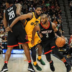 Houston Rockets guard Chris Paul (3) uses forward Tarik Black (28) to screen out Utah Jazz forward Royce O'Neale (23) as the Utah Jazz host the Houston Rockets at Vivint Smart Home Arena in Salt Lake City on Thursday, Dec. 7, 2017.