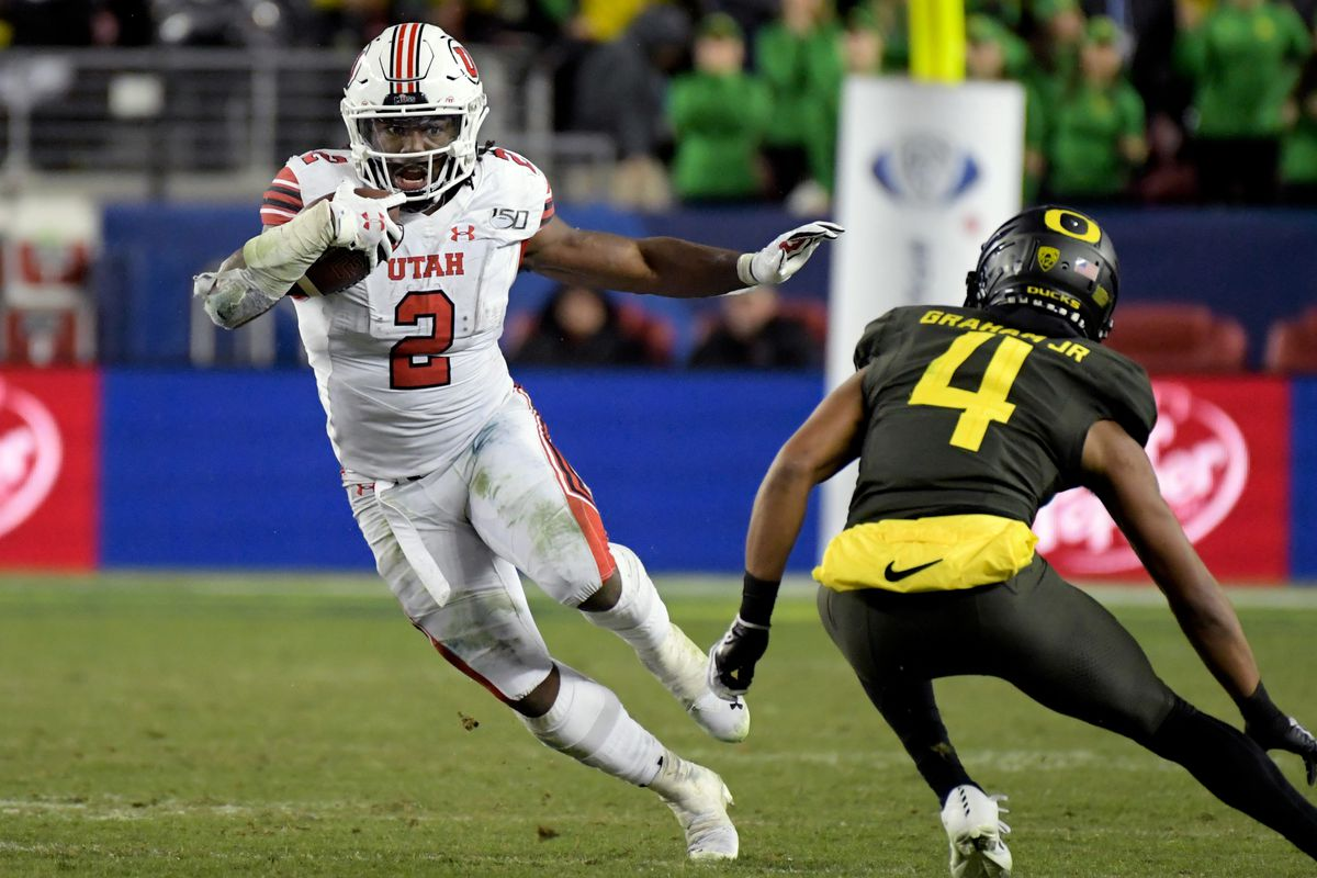 Utah Utes running back Zack Moss rushes against Oregon Ducks cornerback Thomas Graham Jr. during the second half of the Pac-12 Conference championship game at Levi's Stadium.
