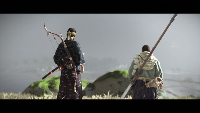 Jin Sakai from Ghost of Tsushima stares into the distance with a monk
