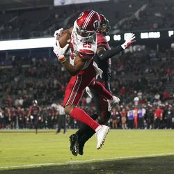 Utah wide receiver Jaylen Dixon (25) catches a pass in the end zone to score in overtime of an NCAA college football game Saturday, Sept. 18, 2021, in Carson, Calif. San Diego State cornerback Noah Tumblin (10) is at right.