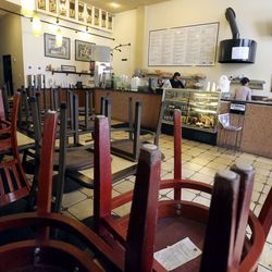 Chairs are stacked on tables since patrons are not allowed to dine in, due to COVID-19 restrictions, at The Robin's Nest in Salt Lake City on Tuesday, March 17, 2020.