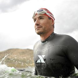 John Karren trains for a swim marathon at a small lake in Herriman.