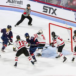 Team USA Defenseman Emily Pfalzer scores a goal against Team Canada at their game in Boston for The Time Is Now tour on Oct 25th, 2017