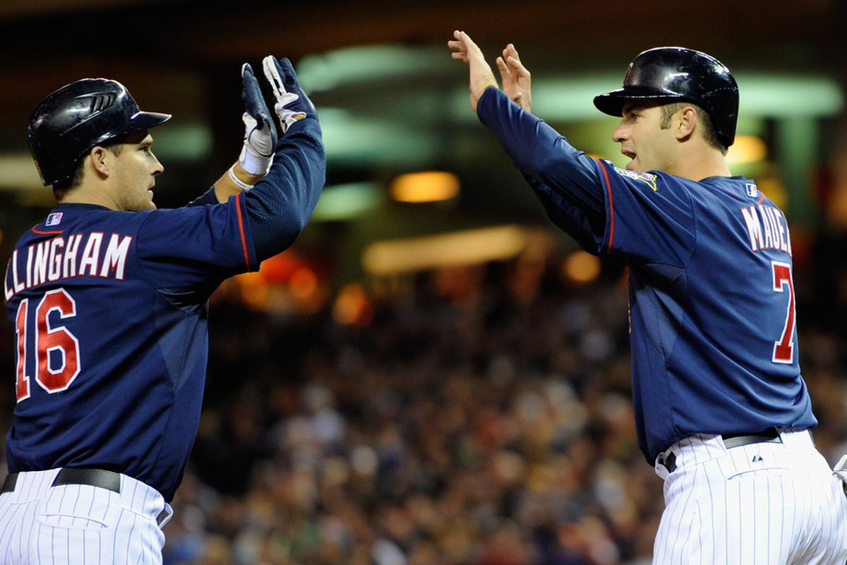 Mauer congratulates Willingham on his 2 run homerun, and asks how he hits that ball so darn hard out of the park.