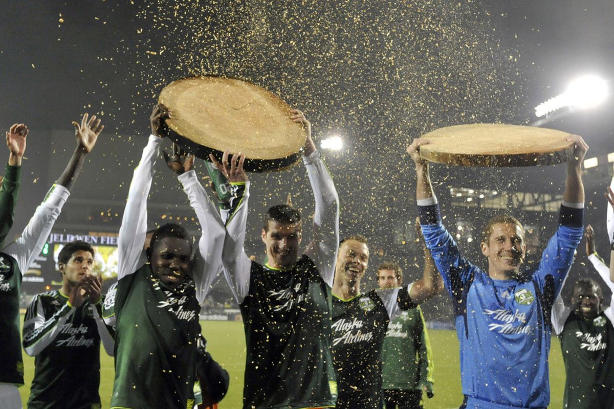 Timbers celebrate with wood after their first shutout win of the season (Photo by Steve Dykes/Getty Images)