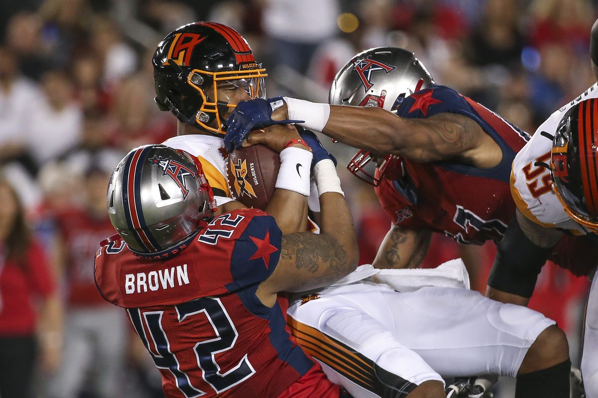 Los Angeles Wildcats quarterback Jalan McClendon is tackled by Houston Roughnecks linebacker Beniquez Brown during the fourth quarter in a XFL football game at TDECU Stadium.