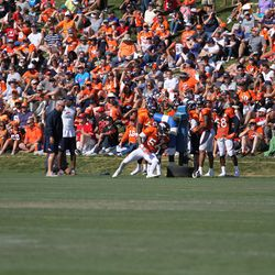 """Broncos OLB Shane Ray moves around """"Brent"""" during drills."""