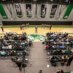 Utah Valley University head basketball coach Mark Pope (center) speaks at the ribbon cutting ceremony for the NUVI Basketball Center on the campus of Utah Valley University.