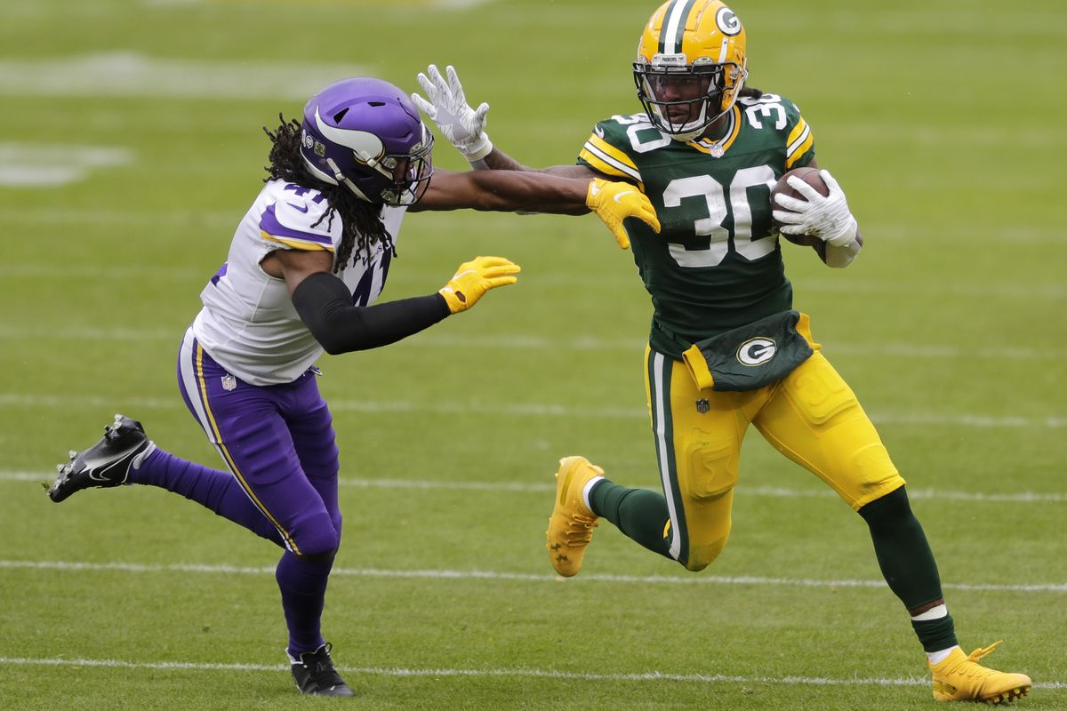 Green Bay Packers running back Jamaal Williams runs for a gain against Minnesota Vikings free safety Anthony Harris at Lambeau Field. Dan Powers/Appleton Post-Crescent via USA TODAY NETWORK