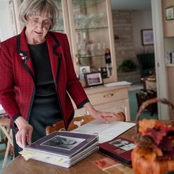 Helen Lower Simmons looks through a binder of images, letters and documents that tell the story of her brother, Max Wendell Lower, while talking to journalists at her home in Logan on Thursday, Nov. 14, 2019. Max Lower was killed when his plane was shot down during the Operation Tidal Wave attacks on Romanian oil refineries during World War II. His remains were recently identified using DNA technology and will soon be returned to his family in Utah.