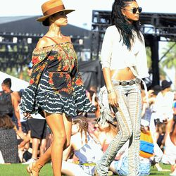 Shanina Shaik, in a Camilla dress, and Chanel Iman, in a Stoned Immaculate top, Roberto Cavalli pants, Isabel Marant boots, Child of Wild belt, vintage earrings, and Quay Australia sunglasses.