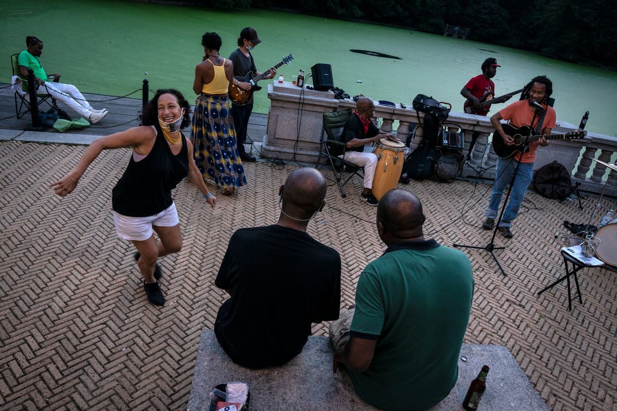A woman dances along to Alegba and Friends near at the Prospect Park Boathouse, July 19, 2020.