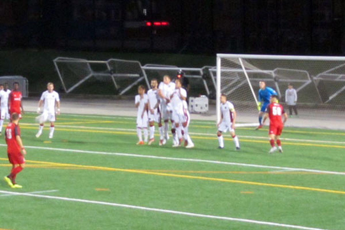 Rocket Robin photo - Toronto FC II's Tsubasa Endoh hits a free-kick towards Atlanta United 2's goal in Friday night's match at Lamport Stadium