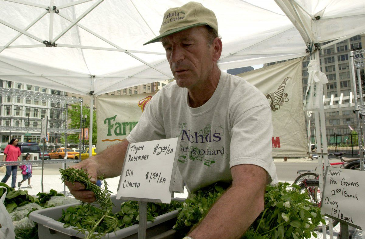 Vendors display their herbs and produce at the Daley Plaza farmers market.   Sun-Times file photo